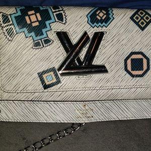 Louis Vuitton Aztec chain wallet. Date code-M61725